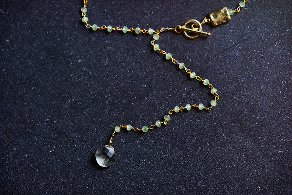 long lariat green beads with peridot drop pendant, front gold toggle clasp