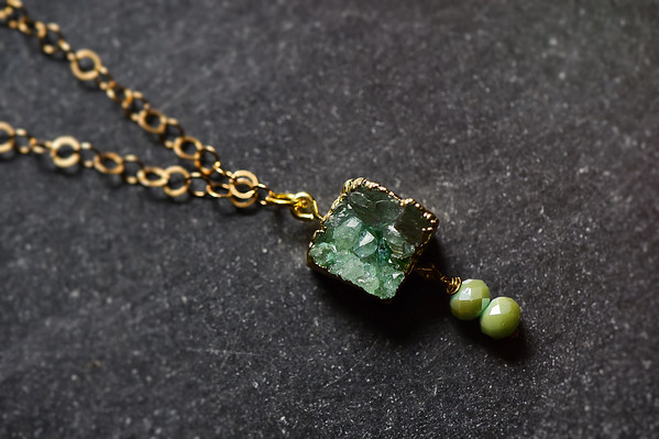 green druzy pendant on gold loopy chain