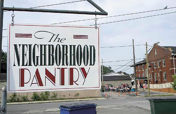 The Neighborhood Pantry, a community food outreach of the Church of Genesis, celebrated its fifth anniversary this week. Clients and staffers gathered in the parking lot behind the Mahoningtown church, right rear, to celebrate. — Dan Irwin