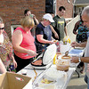 Church of Genesis volunteers make sure their are plenty of hotdogs and condiments. — Dan Irwin
