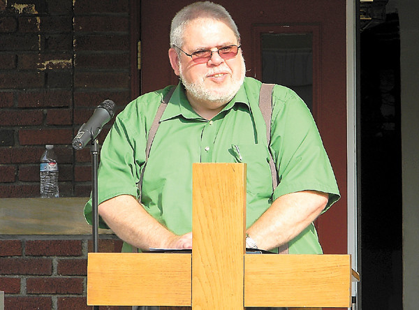 The Rev. Ron Eade, pastor of the Church of Genesis, emceed a program looking back on The Neighborhood Pantry's first five years. — Dan Irwin
