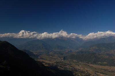 The Annapurna range sticking out above the clouds. There are some 8000m+ mountains in there!