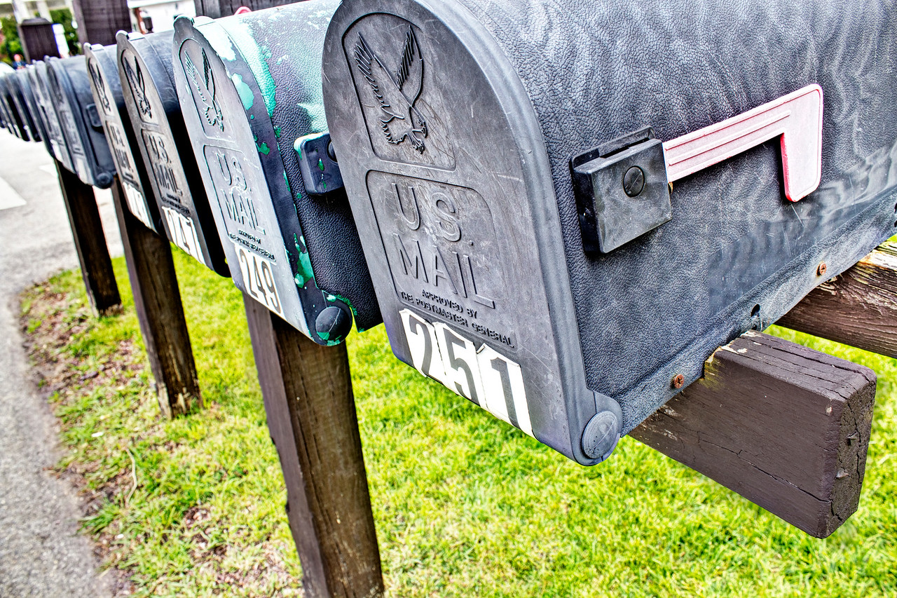 The tangible past | Long Grove, IL has its timeless elements, but the rows of mailboxes lining some of the town's streets feel distinctly of the past. Email is so temporary compared to a handwritten letter, and the grit of the aluminum, peeling numbers and rusted nails on these boxes seem to relate to the tangible nature of an old letter. Don't suspect we'll throw too many emails in a box to read for later.