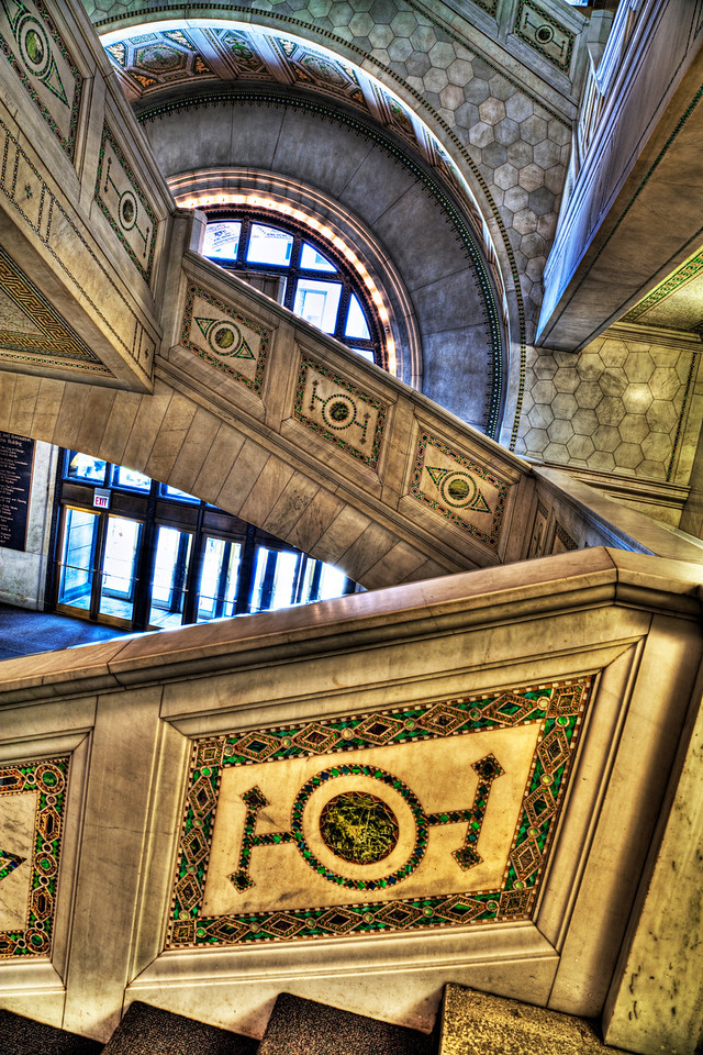 Stairs to the dome | I'll rarely post photos from the same scene on back-to-back days, but this one needs a bit of context, I believe. To get to the domed roof I published yesterday you climb this masterpiece of a staircase within the Chicago Cultural Center. The marble is so solid it's as if it could last forever. There are a lot of great staircases in some of the older buildings in Chicago. I'll have to find and share a few more during the lifetime of this blog.