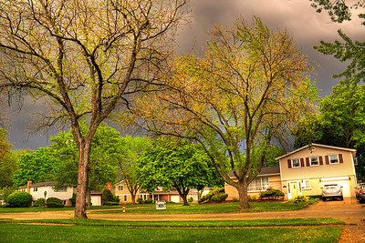 That golden glow before a storm | I've heard people say everything goes green before a tornado. Often times before an afternoon storm the sunlight ahead of the front seems to bounce off the dark clouds to produce a golden light that tugs at the greens and makes them pop. The yellows jump out at you, too.