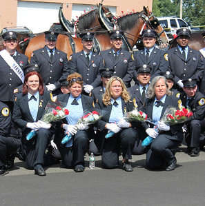 Dept 9 Ladies Aux posing with Clydesdale Horses before parade.
