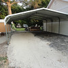 Half of the carport was asphalt and the other rock