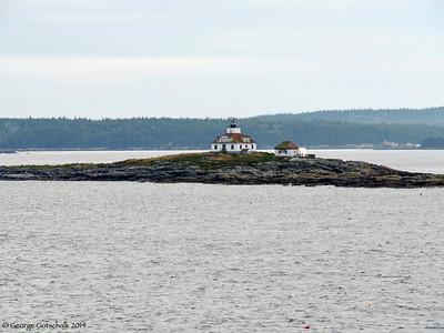 Island lighthouse leaving Portland Maine
