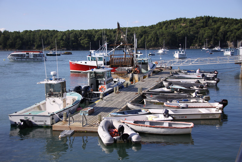More working boats and ship tender in the background in Bar Harbor.