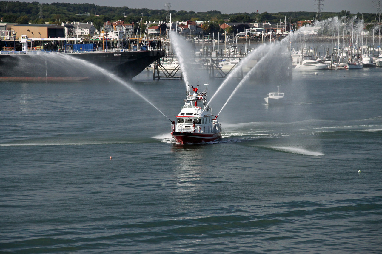 Portland Fire Boat greeting Enchantment of the Seas