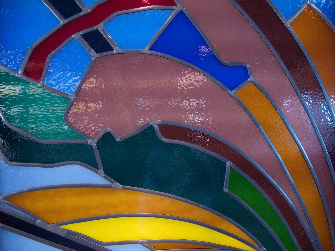 Stained glass at the head of a staircase on Enchantment.