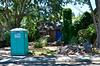 Demolition continues - pile of rubble, and the porta-potty that we had for 3 weeks