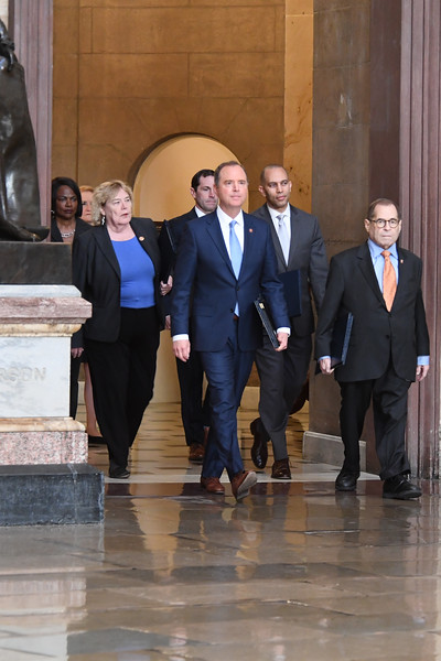 House Managers for the Trump Impeachment Trial  walk over the articles of Impeachment to The Senate