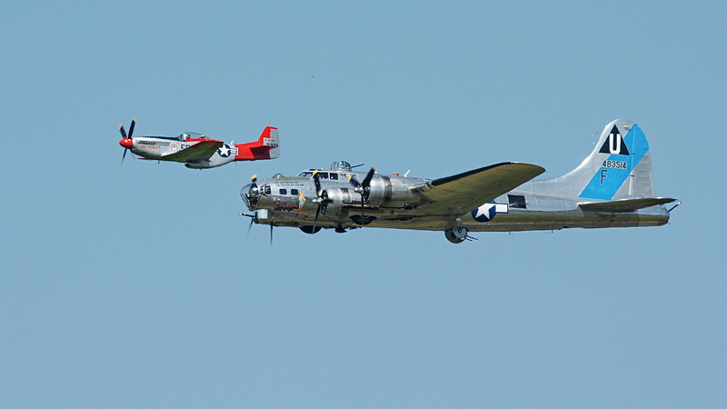 """P-51D and B-17G at Bellingham Airfield about 800m+ distant & some heat haze unfortunately.  Caught me by surprise and camera was not dialed in for aerial shots.<br /> More shots here >> <a href=""""http://newsy.smugmug.com/Airplanes/Bellingham-2012"""">http://newsy.smugmug.com/Airplanes/Bellingham-2012</a>"""