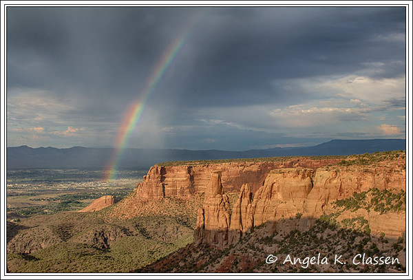 A rainbow bursts into life over the Kissing Couple, Colorado National Monument, Colorado