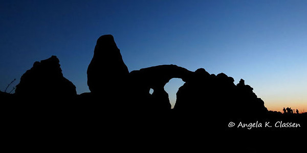 "A small cluster of photographers gathers near Turret Arch in Arches National Park, Utah, to shoot the ""super moon"" event"