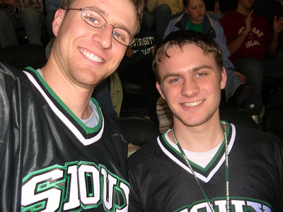 From Whence It Began:  SIOUX YEEEAH YEEEEEAAAAAH!!!!: The actual start of the roadtrip was the Friday before the 1st weekend of Spring Break when we watched the Sioux CRUSH the 'dogs 8-2 in the 1st game of UND's WCHA 2005 playoff run (which culminated in a 3rd place victory over the Gophers! Ha! Stupid Gophers!!!). After this game we drove over to the 'cities for supplies.  But I didn't actually have a picture of the 'dogs game, so this is just one of bro Shane and I at an earlier game. Its like instant pudding; quick, easy, and almost real!