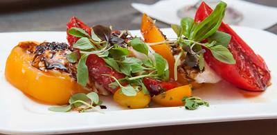 Florida Yellow Beefsteak, Heirloom and Toybox Tomatoes, Aged Balsamico, Exotic Peppercorns, Petite Basil, and Provençal Extra Virgin Olive Oil *