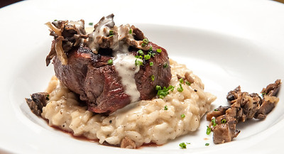 Wild Mushroom Filet Mignon served with Wild Mushroom Risotto and White Truffle Butter Sauce *