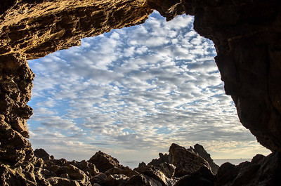 No, it isn't the Batcave. But it is the cave below the vista point in Corona del Mar. I had to sit in some wet sand to get this shot. Made for a cold ride home. :-)