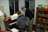 Jeff and Cooper consult on which piano features to employ in next song.