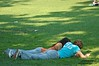 A couple, relaxing on Sheep Meadow, Central Park; Levels corrected on PSE 6.0