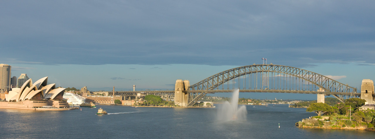 Entry into Syndey harbor.  Sydney Opera House and iconic harbor bridge.  Each ship's first visit to the port warrants a fire boat escort.
