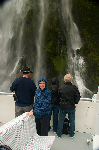 "Day 10<br /> 2/28/2009 – Saturday<br /> The Bus to Milford Sound<br /> <br /> Here's Ali standing next to one of themany Milford Sound waterfalls. . . <br /> <br /> Well It's cloudy today but not raining. We decided to take a break from driving ourselves and take the tiny tour bus hosted by the top 10 Holiday Park to Milford Sound.<br /> <br /> We were wooped for the ride back to Te Anau and I was quite happy that Bryce diddn't feel obligated to entertain the entire way home. <br /> <br /> Having been delivered safely back to the top 10 (I noted that even though I haddn't had to drive my real was still sore). <br /> <br /> We opted for a fine dinner at the ""Spagetteria"" where the servers spoke real Kiwi and were treated to several interesting conversations. Dick and I has to say ""whaaat???"" more than once. . .  The affirmative response to every question-""Yip"". ( I was dieing to ask ""are you a small yappy doggie?"" the answer would have been ""Yip!"", <br /> <br /> When we entered the restaurant with to take away menus the young lady came to our table and said ""let me get you a popa menu"", I thought she said let me get you a papa menu (you know kid's menu, seniors menu, papa menu. . .) turns out after my ""Whaaaat??? That she was offering a proper menu- Scheech!!"