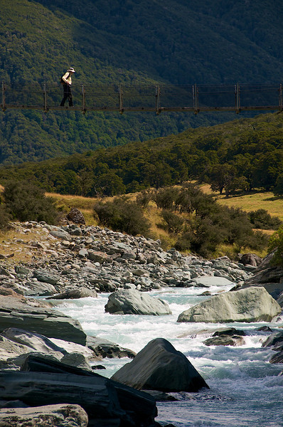 "Here's Dick crossing the swing bridge on the track up to Rob Roy Glacier with the famous Matukituki River below (try saying ""matukituki"" three times fast. . .  fun huh!)<br /> <br /> Back to the Top 10 thinking about doing laundry- in the morning."