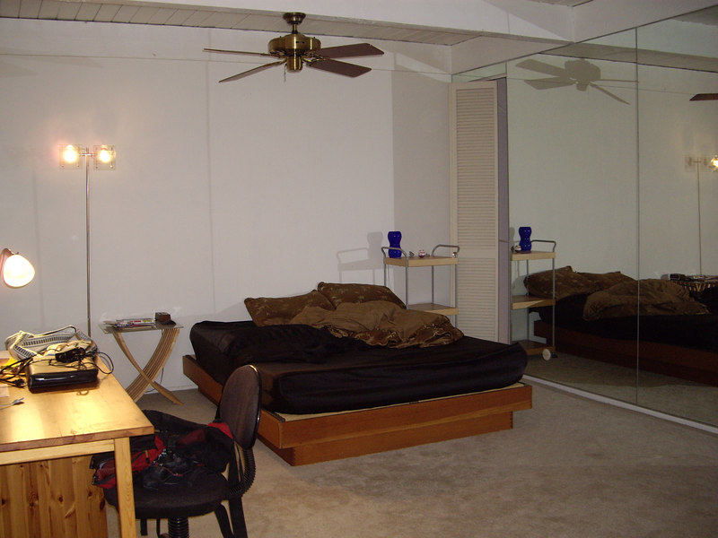 """Master bedroom on the 2nd floor. The """"windows"""" on the right overlooking the living room."""