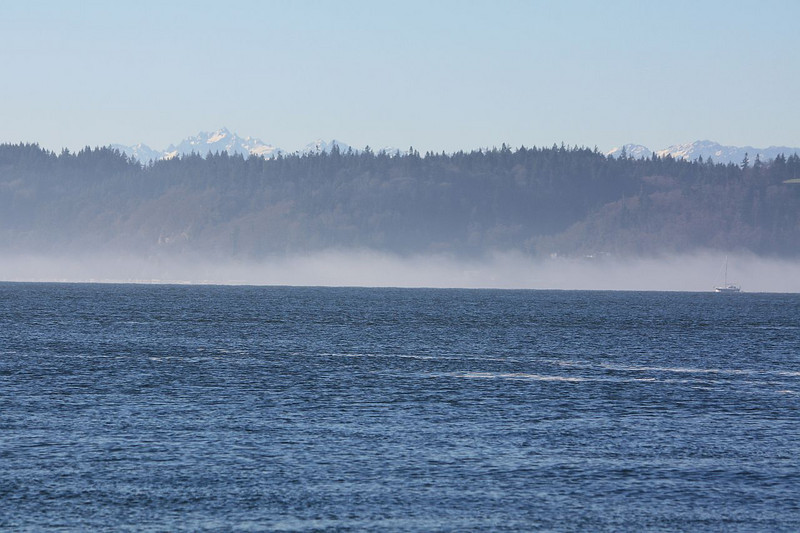 View from Mukilteo, across the Puget Sound, over Whidbey Island, and with the Olympic Mountains rising in the background.