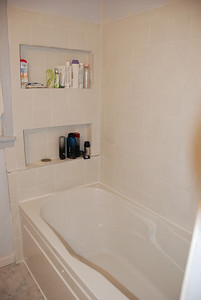 After: Back of shower with new shelves.