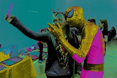 12/3/2016 Mike Orazzi | Staff Amber Ruff photographs herself with Spiderman, Anthony Kosienski, during the  New Britain YWCA's Winter Wonderland Weekend on Saturday.