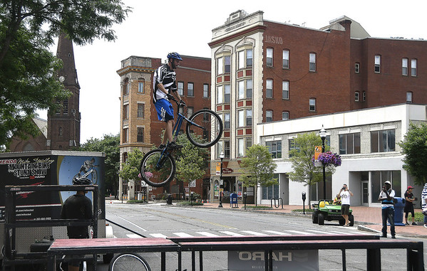 7/8/2017 Mike Orazzi | Staff Joe Steinicki performs stunts on his bike during the 4th Annual Bike Safety Day in downtown New Britain Saturday.
