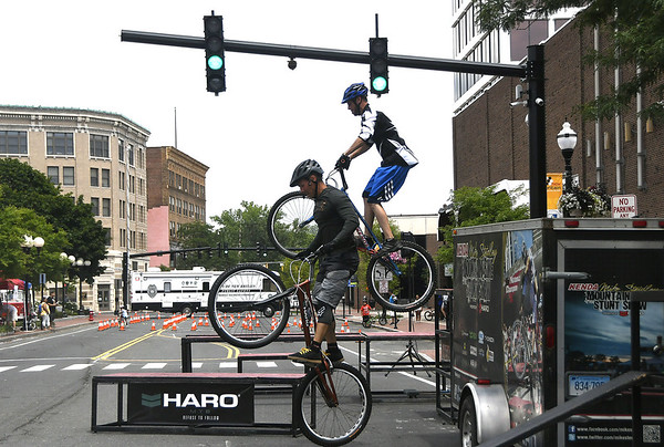 7/8/2017 Mike Orazzi | Staff Mike Steidley and Joe Steinicki perform stunts on their bikes during the 4th Annual Bike Safety Day in downtown New Britain Saturday.