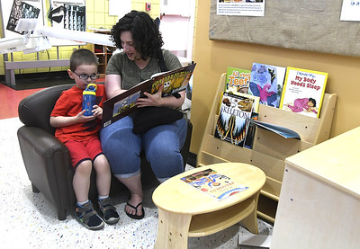 7/1/2017 Mike Orazzi | Staff Rachel Keesler while reading to her son Jacob while at the Imagine Nation Museum Early Learning Center Saturday morning in Bristol during Patriotic Day & Lo's Sweet Treat Day.