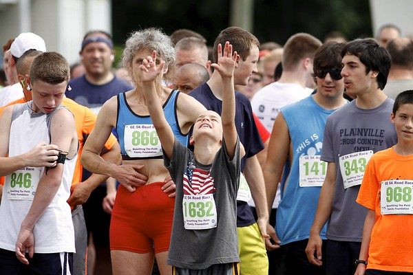 Kevin Bartram | Staff Runners await the start of the GE Petit Family Foundation Road Race 5K on Sunday in Plainville.