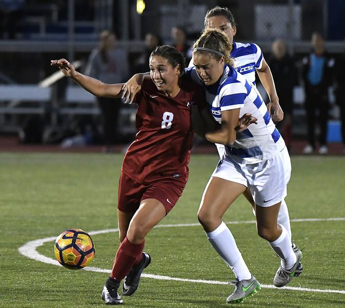9/1/2017 Mike Orazzi | Staff CCSU's Nicole Russell (15) and Harvard's Lauren Raimondo (8) during the CCSU Soccer Tournament in New Britain Friday night.