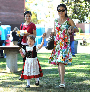 9/23/2017 Mike Orazzi   Staff JieJie Zong (left) and Victoria Freitag and her mom Yanyan during the St. Peter Church Oktoberfest in New Britain Saturday.