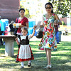 9/23/2017 Mike Orazzi | Staff<br /> JieJie Zong (left) and Victoria Freitag and her mom Yanyan during the St. Peter Church Oktoberfest in New Britain Saturday.