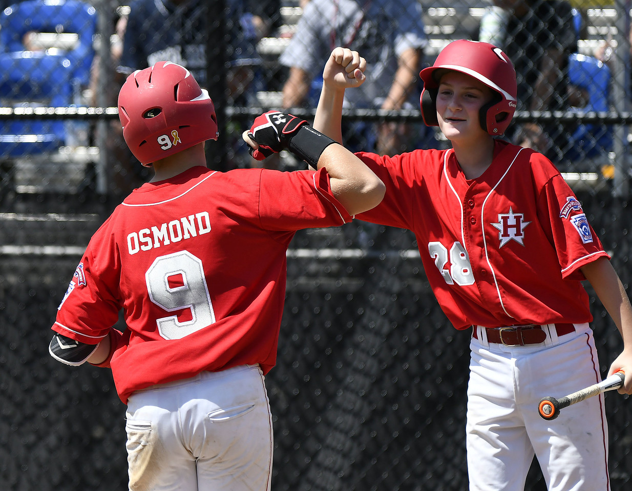 8/9/2017 Mike Orazzi | Staff New Jersey's JR Osmond (9) after his home run during the Eastern Regional Little League Tournament in Bristol Wednesday afternoon.