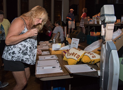 09/21/17 Wesley Bunnell   Staff  Gail Boughton of New Britain looks over raffles prizes at the 6th Annual BENefit for the NBHS Marching Band. The annual fundraiser is in memory of Ben Cheney, a 2008 graduate who passed away.