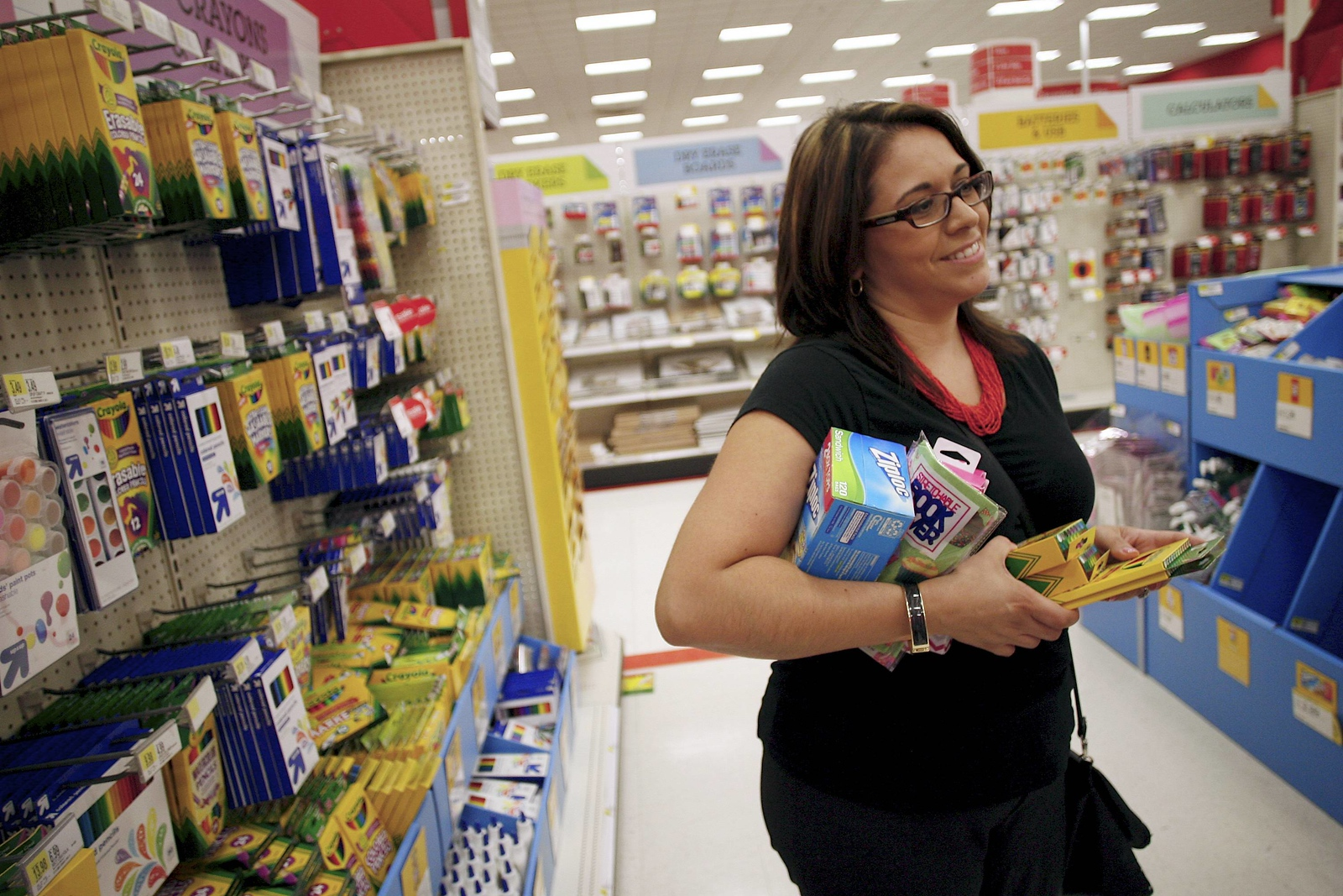 **Story by Scott**  Kevin Bartram | Staff Maria Santilli shops for school supplies at the Target store in New Britain on Friday.
