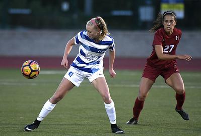9/1/2017 Mike Orazzi | Staff CCSU's Jenna Rae Covello (22) and Harvard's Candy Janachowski (27) during the CCSU Soccer Tournament in New Britain Friday night.