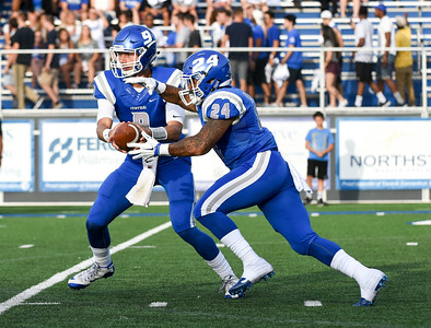 090216  Wesley Bunnell | Staff  CCSU QB #9 Jacob Dolegala hands off to RB #24 Brenden Lytton. CCSU football held their season and home opener Friday night Sept 2 against Lafyette College.