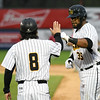 042617  Wesley Bunnell | Staff<br /> <br /> New Britain Bees vs Lancaster Barnstormers on Wednesday evening. Daisuke Yoshida (8) high fives Jovan Rosa (35) after he Rosa reaches first on a hit.