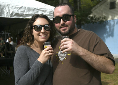 9/2/2017 Mike Orazzi | Staff Kayla Medeiros and Evan Baker during the 2nd CT Hops for Hope beer festival held at Falcon Field in New Britain Saturday.