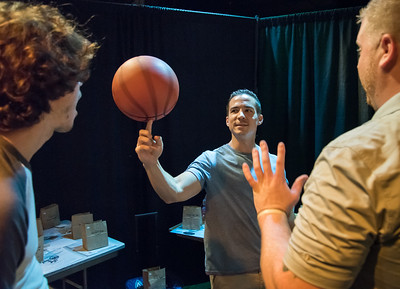 09/21/17 Wesley Bunnell   Staff  Sean Gedraitis of New Britain spins a basketball from the from the raffle prize table at the 6th Annual BENefit for the NBHS Marching Band. The annual fundraiser is in memory of Ben Cheney, a 2008 graduate who passed away.