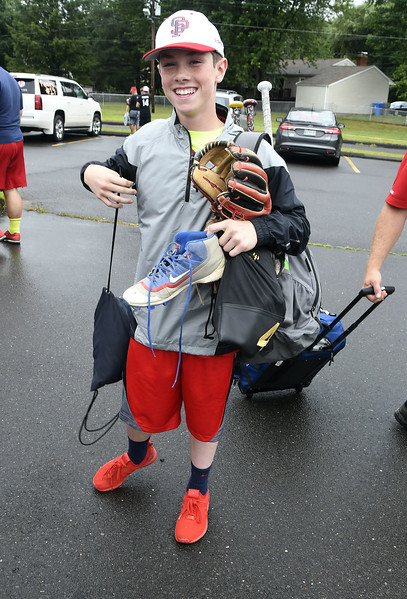 8/5/2017 Mike Orazzi | Staff South Portland American Little League's Johnny Poole arrives at the Giamatti Little League Center in Bristol for the start of the Eastern Regional Little Baseball Tournament in Bristol Saturday.