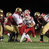 11/17/17  Wesley Bunnell | Staff<br /> <br /> New Britain football defeated Berlin in its last game to finish 5-5 on the season at Veterans Stadium on Friday evening. Marco Scarano (33) carries the ball with a block from Paul D'Amore (76).